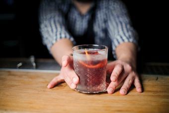 Barman at work, serving cocktails