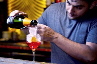 Bartender preparing a spritz aperol