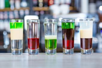 Different alcoholic shots cocktails served on bar counter
