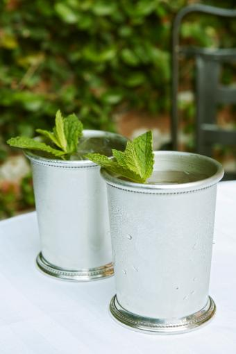 Two mint julep on a table Cancel Create