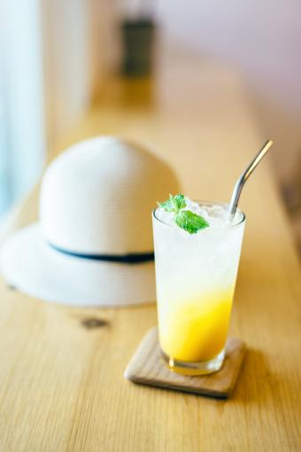 A glass of refreshing iced passion fruit and mango lemonade