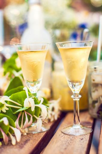Two honeysuckle cocktails on a table