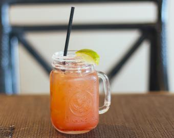 Tropical pink cocktail in mason jar