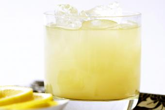 Pineapple juice with tequila and ice in glass