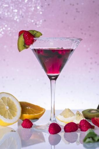 Fruit cocktail with sugar and salt, garnished with pieces of fresh fruit