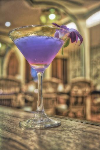 Lavender gin cocktail with orchid garish