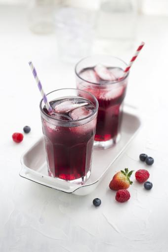 Gin and fruits in drinking glass