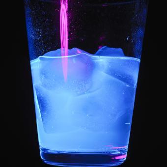 Ultraviolet blue light on drink in glass