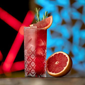 Refreshing Cocktail with ice, rosemary and grapefruit or red sicilian orange