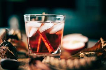Apple cider cocktail with cinnamon sticks