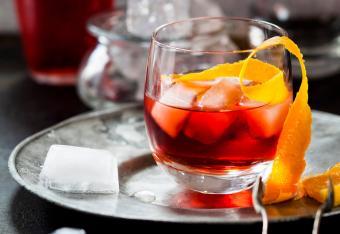 Negroni with orange peel and ice cubes