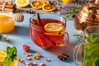 Hot Toddy with herbs on blue wood background