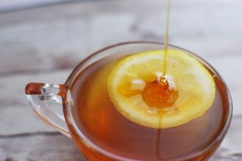 Honey Poured Over Lemon in Glass with Honey Toddy