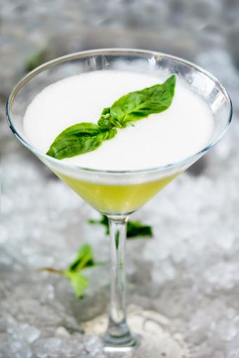 Apple martini Cocktail Garnish With Mint In Glass On Crushed Ice