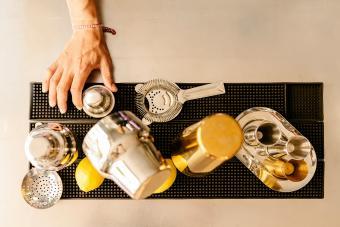 Cropped Hand Of Bartender Making Drink At Bar