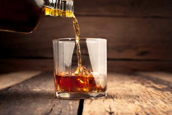 Pouring glass of whiskey