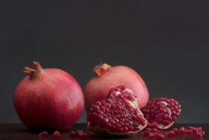 Fresh Pomegranate Fruit on Dark Background