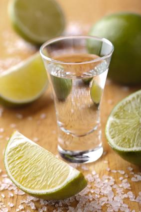 Tequila shot with limes and salt