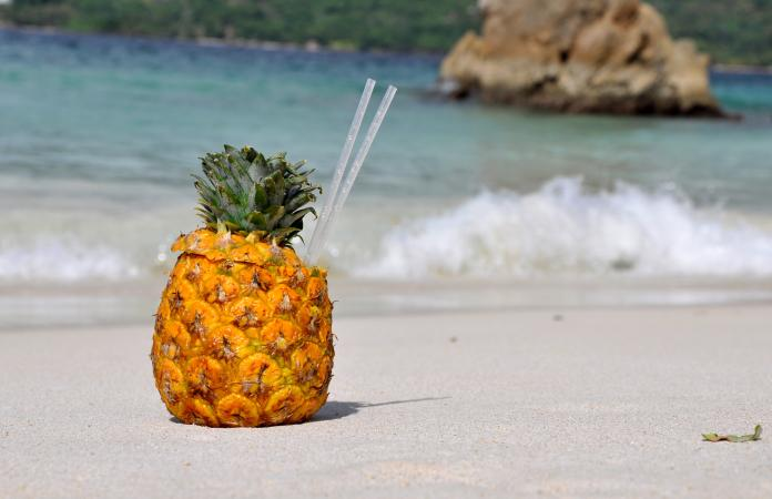 Drinking Straws In Pineapple At Beach