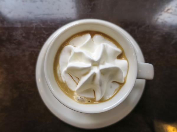 Caramel coffee with whipped cream