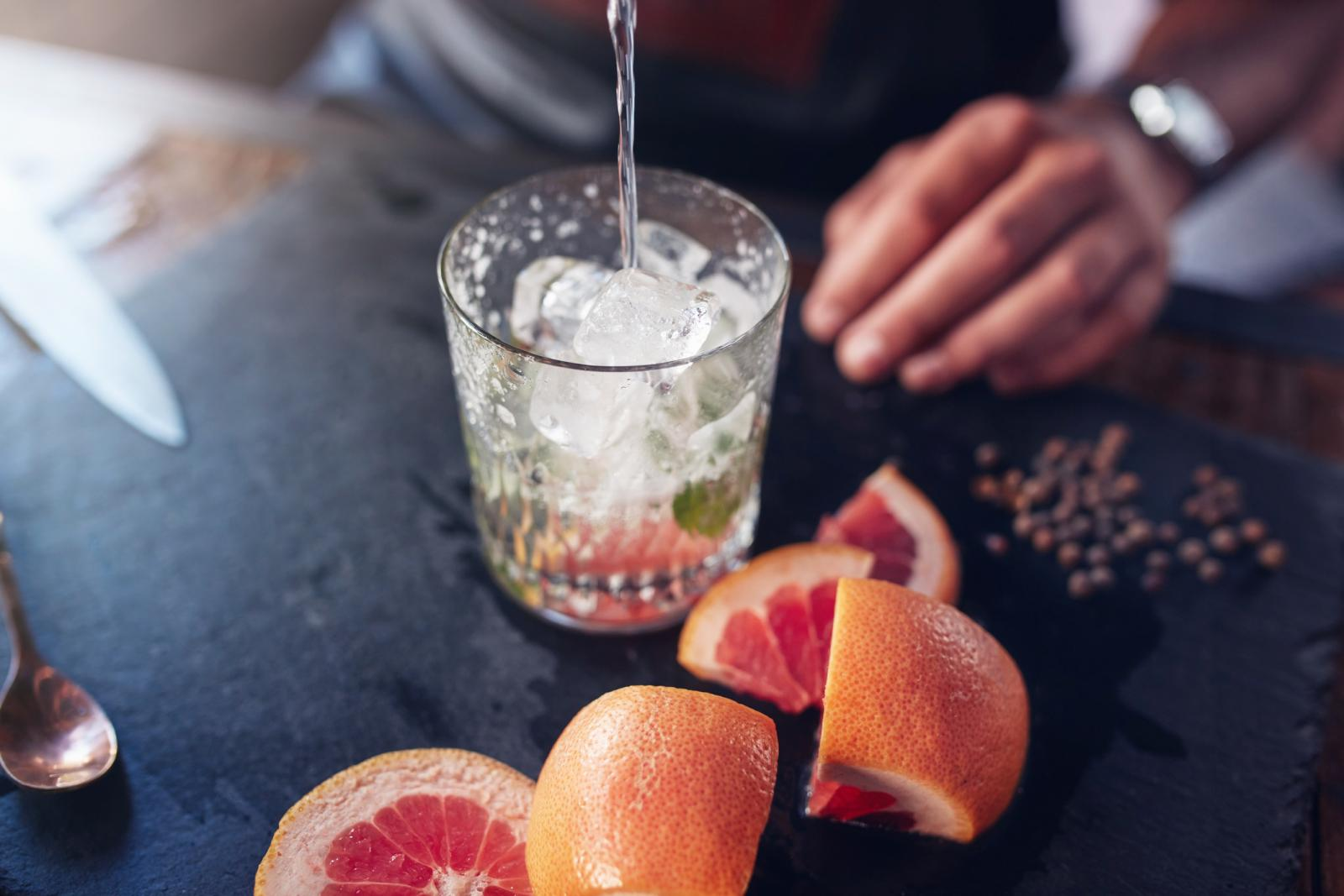 Bartender preparing grapefruit cocktail