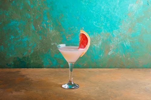 Brown derby cocktail with grapefruit garnish