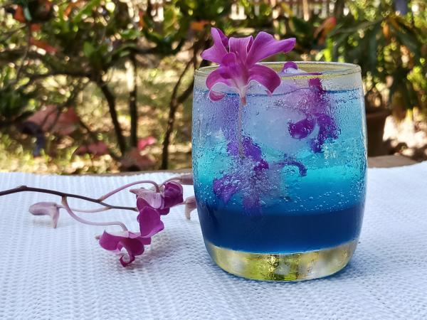 Blue Hawaii punch garnished with flowers