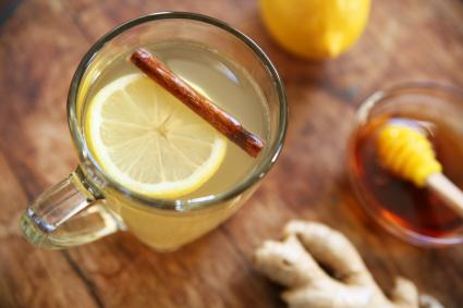 Hot whiskey toddy drink with lemon, honey, cinnamon, and ginger