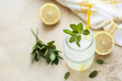 Fresh lemonade with sage in jar