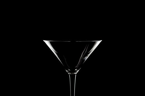 Martini glass on black background