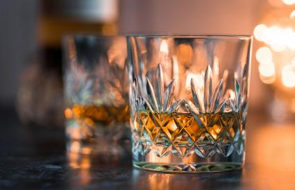 Crystal glasses of whisky