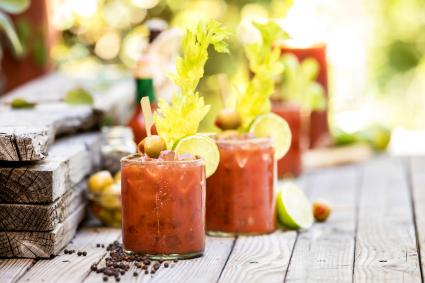 Group of bloody mary's on an outside table ready for a party