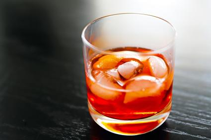 Negroni, bright, bitter sweet Italian cocktail made with sweet red vermouth, gin, campari, ice and an orange peel