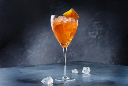 Traditional Italian aperitif Aperol Spriz with orange and ice