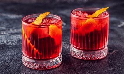 Negroni cocktail with orange peel and ice