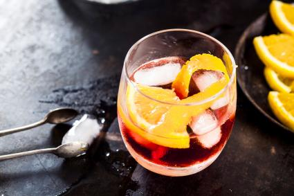 Old fashion with orange peel and ice cubes
