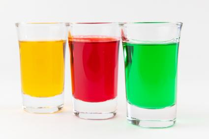 Multi-color liquors on shot glasses