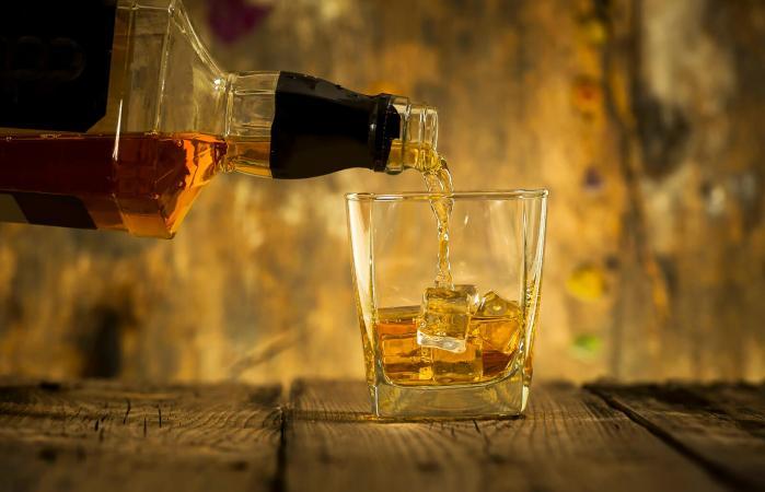 Barman pouring bourbon