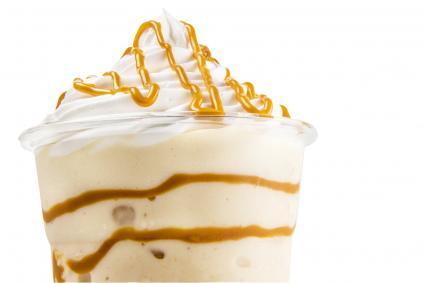 Glass of Baileys milkshake with caramel on top