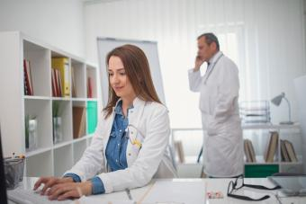 doctor and physician assistant in office