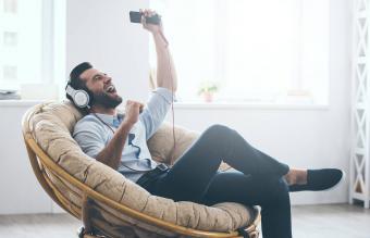young man in headphones gesturing