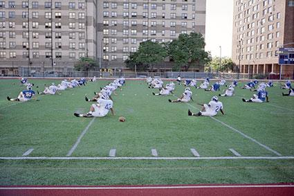 College football team warming up at practice