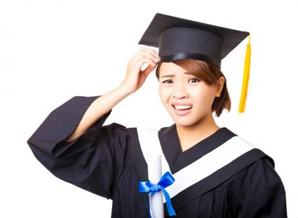 Confused young woman graduating