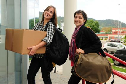 Students moving in to College dorm