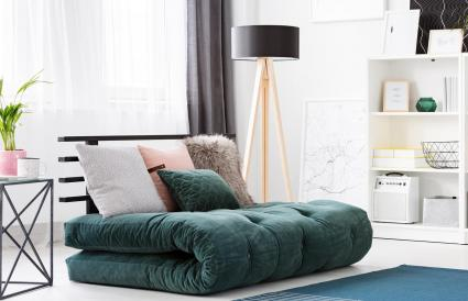 Green futon in modern bedroom