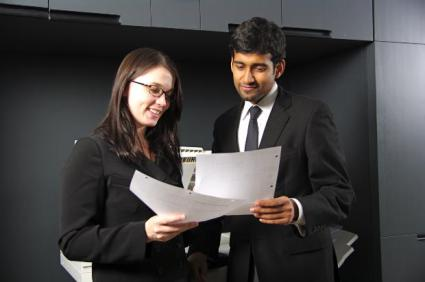 Two young professionals in an office