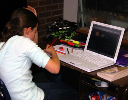 A student studying with a laptop