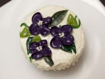 A cupcake decorated with flowers.