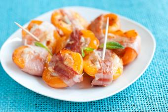Apricots wrapped in bacon; copyright Arseniya Pavlova at Dreamstime.com