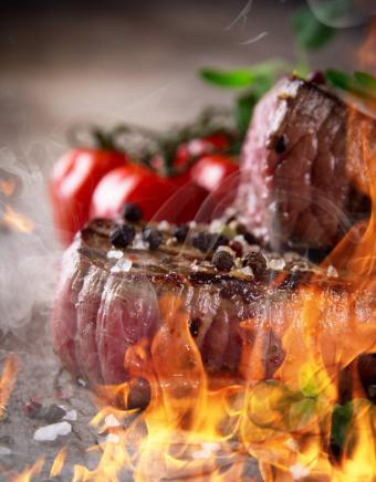 Steak on wood with vegetables